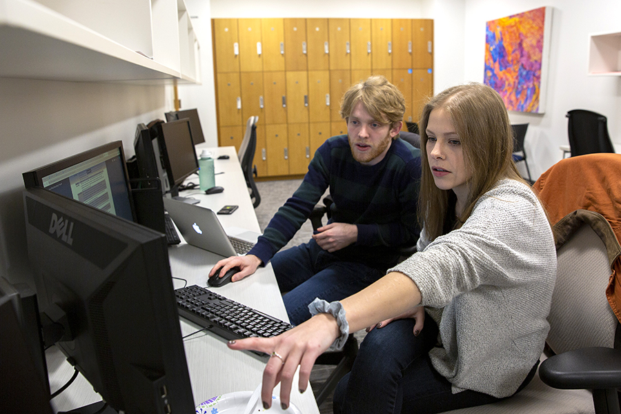 Two graduate students in the Department of Public Policy work on group projects at the Hartford campus.